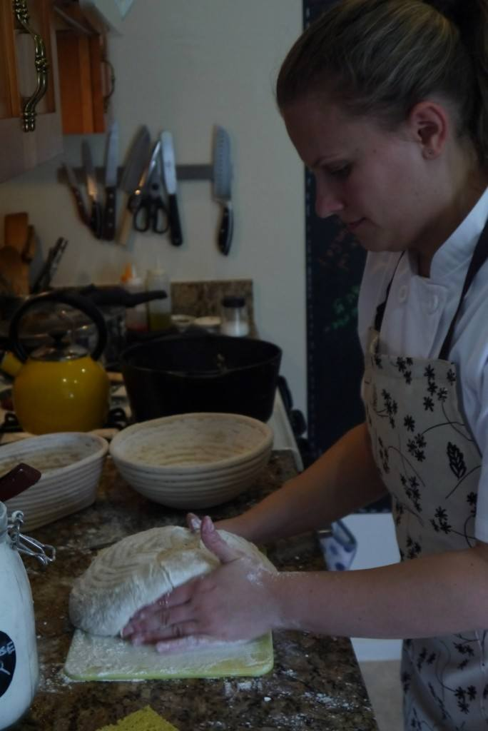 picking the loaf with my hands and placing inside the pre-warmed Dutch oven.
