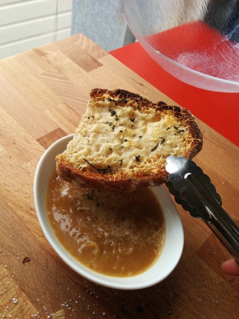 toasted with parmesan and thyme on a classic French onion soup